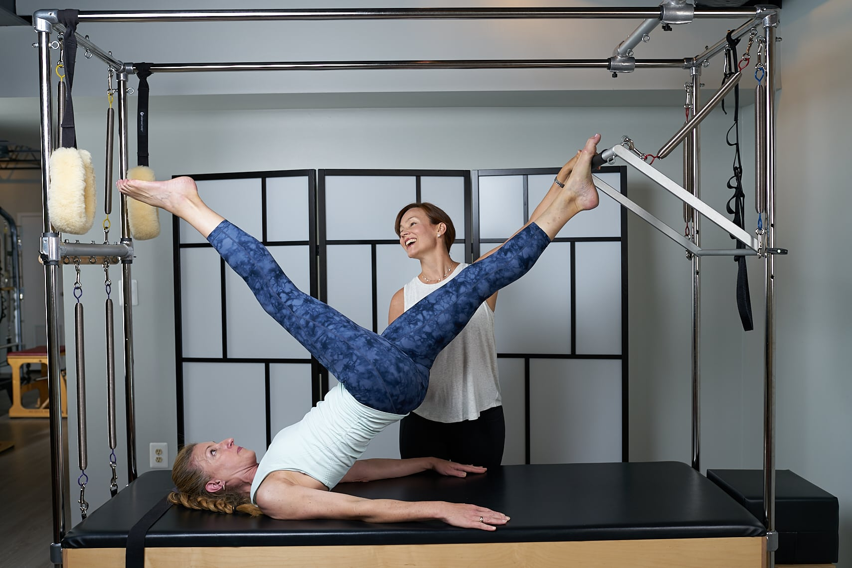 Mariah Sotelino teaching a private client on a Cadillac/ Trapeze table